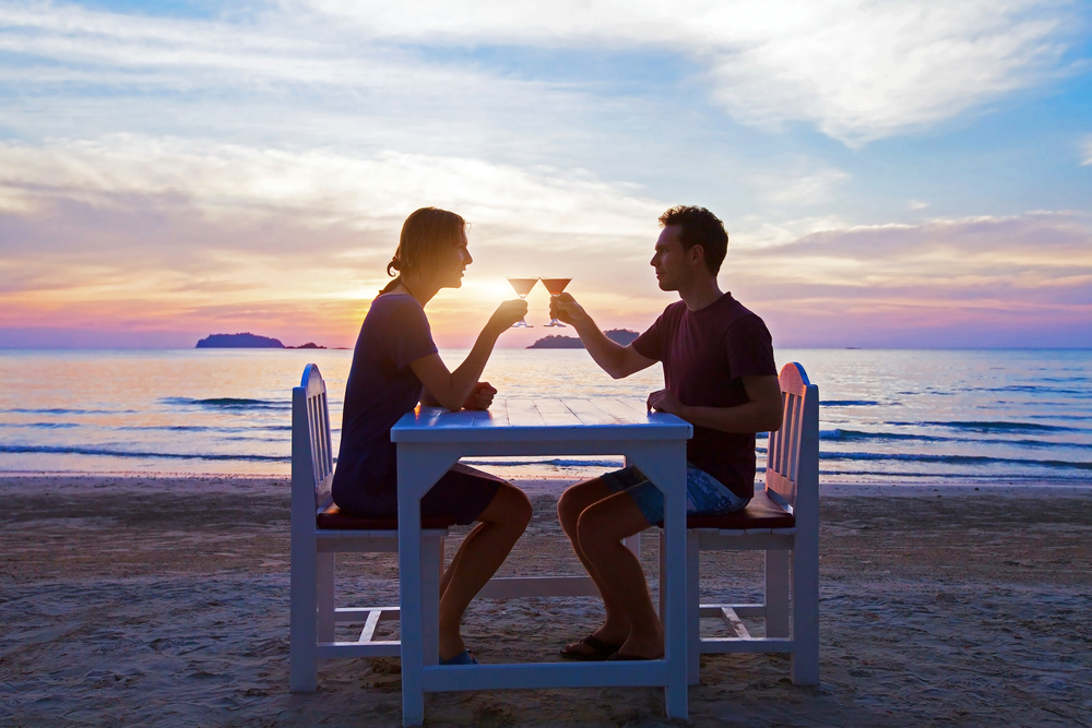 Romantic dinner on the beach in luxury restaurant.jpg
